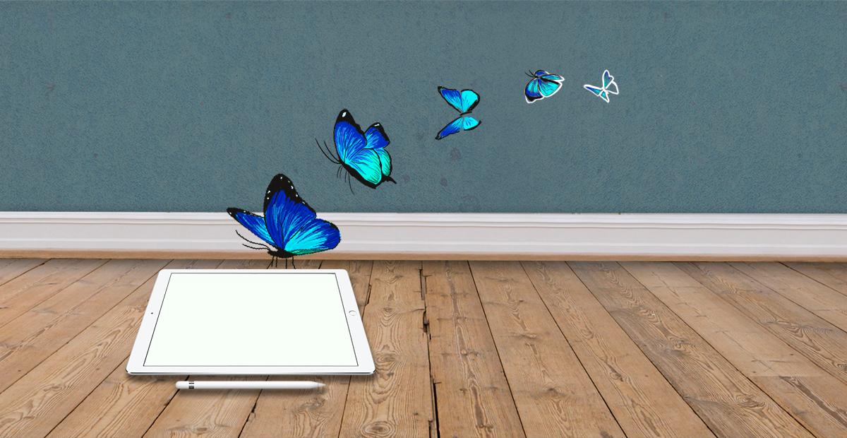 Våra tjänster Grafisk Design Bilden visar hur en blå fjäril lander på en iPad